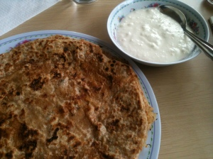 A typical Punjabi breakfast of mooli paratha and thick yoghurt.
